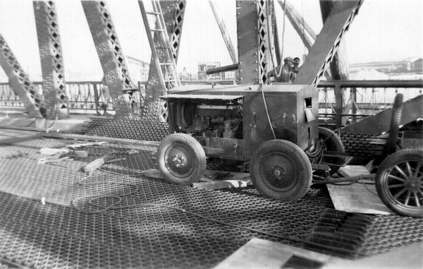 Harry Francel's welder on High St. Bridge, Oakland, 1939